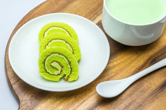 Cake rolls on wooden plate Stock Photography