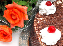 Cake and rose flowers Stock Image