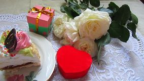 Cake, roses and gifts boxes stock footage