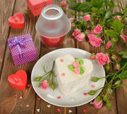 Cake and roses Stock Images