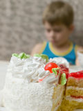 Cake and sad boy Stock Photography