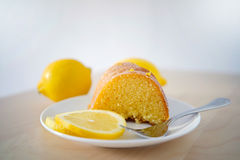 Cake on a saucer with lemon slices Stock Photo