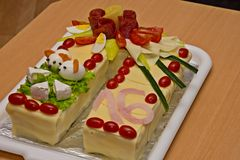 Cake of sausages and cheese. In the shape of a horseshoe stock images