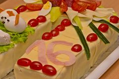 Cake of sausages and cheese. In the shape of a horseshoe stock photography