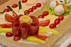 Cake of sausages and cheese. In the shape of a horseshoe royalty free stock photography