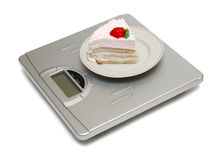 Cake on scales Royalty Free Stock Photo