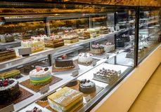 Cake Selection on Fridge Display at Coffee Shop, Deli or Restaurant. Various Cake Selection on Fridge Display at Coffee Shop, Deli or Restaurant. There are royalty free stock image
