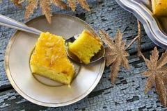 Cake with semolina and jam. Cake with semolina, turmeric and apricot jam Royalty Free Stock Photo