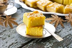 Cake with semolina and jam. Cake with semolina, turmeric and apricot jam Stock Photo