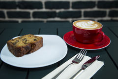 Cake served with coffee. On the table royalty free stock photo