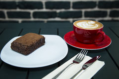 Cake served with coffee Royalty Free Stock Image