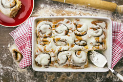Cake server sitting in cinnamon roll baking dish Stock Images