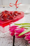 Cake in the shape of hearts and tulips Stock Image