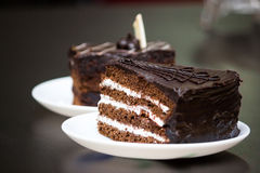 Cake slice. Chocolate cocoa black cake slice on a plate on the table. Delicious snack stock photography