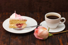 Cake slice and coffee cup with rose on wooden background Royalty Free Stock Images