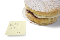 Cake slice with 'eat me' sign on sticky notepaper Stock Photography