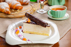 Cake slice. A piece of cake on a plate served with tea stock photography