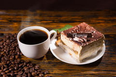 Cake slice in plate with coffee and beans Royalty Free Stock Photo