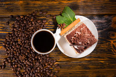 Cake slice in plate with coffee and beans Stock Photo
