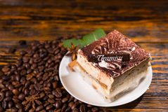 Cake slice in plate surrounded by coffee beans Royalty Free Stock Image