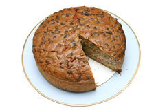 Cake with slice removed. Home made fruit cake with a slice missing, isolated on a white background royalty free stock photos