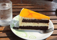 Cake slice and sweet orange Stock Photography