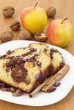 Cake slices. Slces of sweet cke on a plate, apples and nuts stock photos