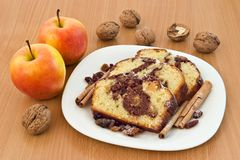 Cake slices. Cakes with apples cinnamon and walnuts royalty free stock photography