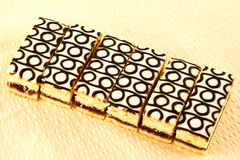 Cake slices. A closeup of a row of sliced bakewell slices Royalty Free Stock Image