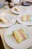 Cake slices on plates Royalty Free Stock Photo
