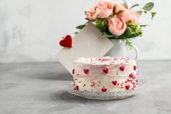 Cake with small hearts and colorful sprinkles on a plate with coffee. Grey stone background. Romantic love concept. Valentine`s d stock photo