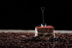 Cake with a small spoon Stock Photos