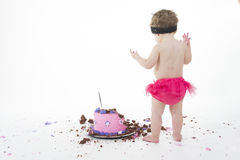 Cake smash shoot: Oh dear! Baby girl and big messy Stock Image