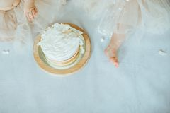 Cake smash. Two little girl eating cake stock photography