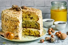 Cake smetannik or general - three layer cake with nut, poppy and raisin. Stuffing and sour cream, Russian cuisine royalty free stock image