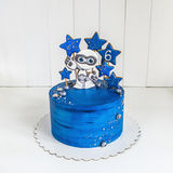 Cake space blue with gingerbread in the form of an alien and the stars, planets and berries Royalty Free Stock Image