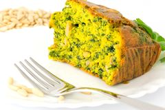 Cake with spinach and pine nuts Royalty Free Stock Photo