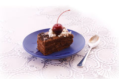 Cake and spoon Royalty Free Stock Image