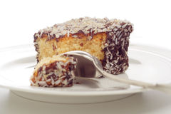 Cake and spoon. Close-up pieces of cake and silver spoon on a plate royalty free stock photos