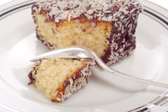 Cake and spoon. Close-up pieces of cake and silver spoon on a plate royalty free stock photo