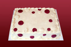 Cake with Spots. A creme cake with burgundy spots has a blank place in the middle for text Royalty Free Stock Image