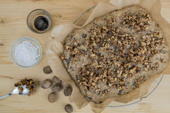 Cake sprinkled with roasted walnuts Stock Photos