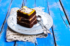 Cake square. Shaped chocolate cakes with cream filling and a glossy finish royalty free stock photography
