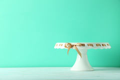 Cake stand. On a green wooden table royalty free stock image