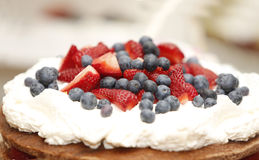 Cake with strawberries and blueberries Stock Photo