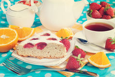 Cake with strawberries and breakfast on the table. Vintage retro