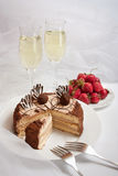 Cake strawberries and champagne Stock Photography