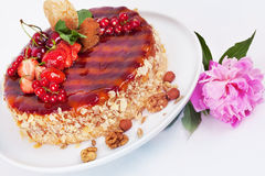 Cake with strawberries currants cherries and nuts Stock Photo