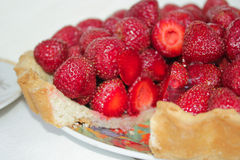 Cake with strawberries. Delicious strawberry cake on a color plate Royalty Free Stock Photo