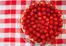 Cake with strawberries and red currants Royalty Free Stock Photography